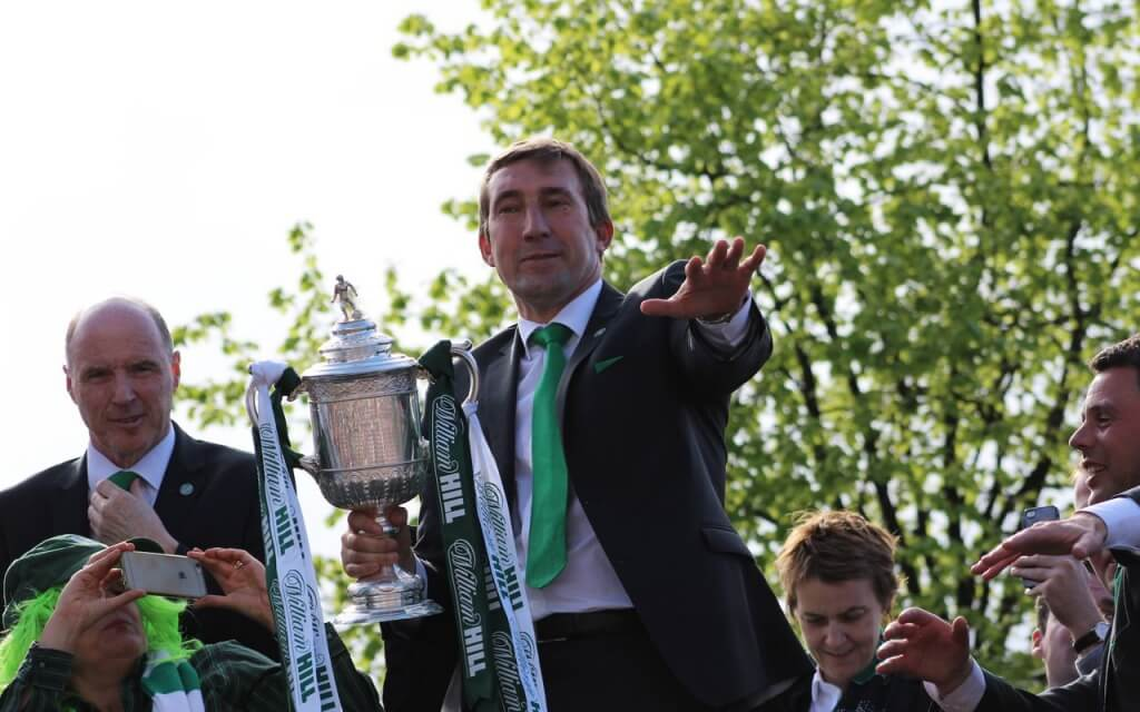 Hibernian head coach Alan Stubbs engages the crowd in song at Leith Links