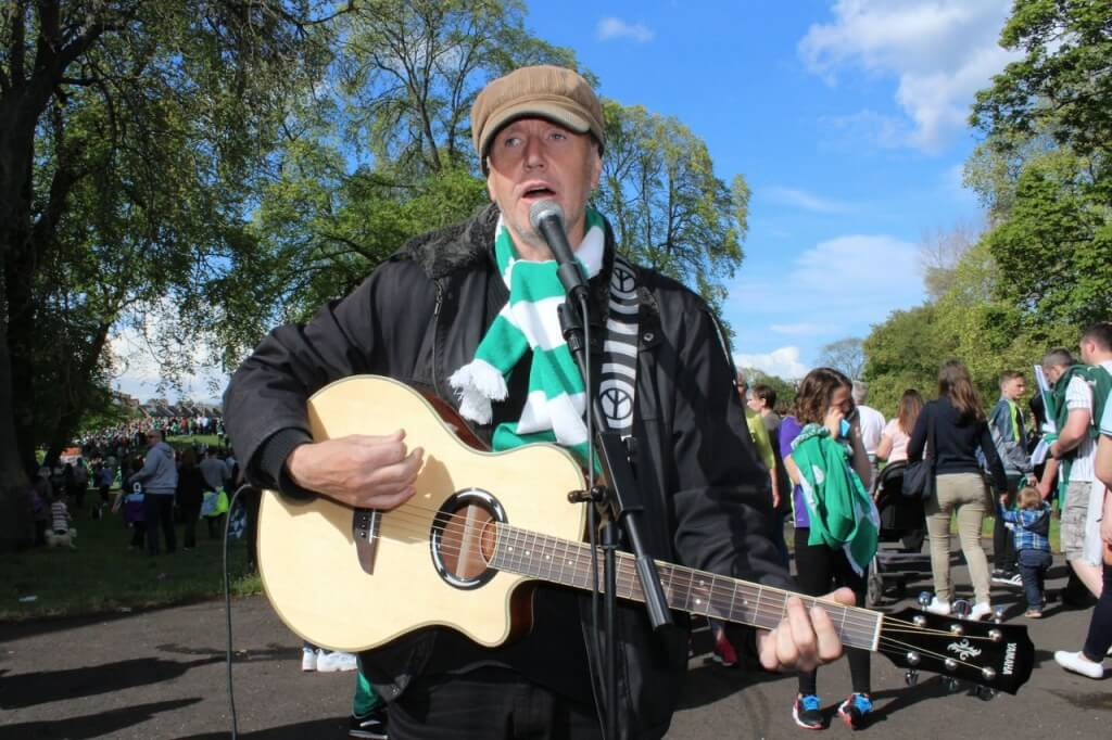 A musician entertains fans on Leith Links