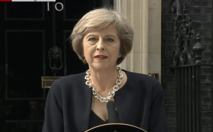 May: tax cut threat