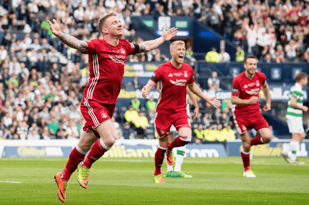 Jonny Hayes celebrates his goal