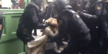 Police drag woman from voting station