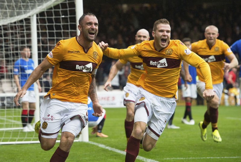 Motherwell captain Peter Hartley celebrates his late equalsier against Rangers at Fir Park