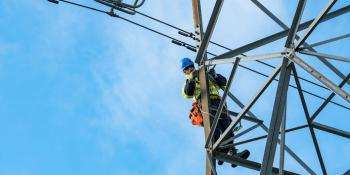 Engineer working on power lines