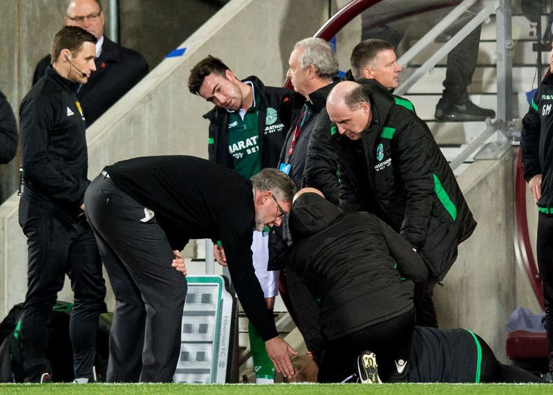 Hearts manager Craig Levein checks on Hibs boss Neil Lennon after appearing to be struct by an object from the crowd.