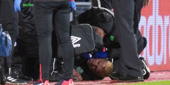 Neil Lennon needed treatment after appearing to be hit by a missile at Tynecastle