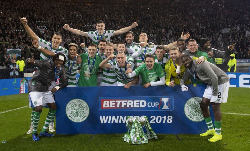 Celtic celebrate their third League Cup win in a row
