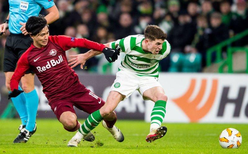 RB Salzburg's Takumi Minamino (left) chases down Celtic's Ryan Christie