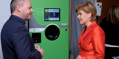 First Minister Nicola Sturgeon is given a demonstration of the Flex reverse vending machine by Envipco's Sion Stanfield at the Scottish Grocers Federation annual conference in October 2018