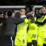 Scott Brown is mobbed by fans after his late winner against Kilmarnock