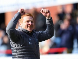 Neil Lennon celebrates Celtic's late win at Dundee