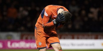 St Mirren keeper Vaclav Hladky reacts after a firecracker was thrown close to him