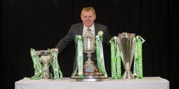 Neil Lennon with Celtic's three trophies