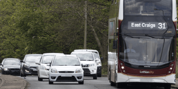 cars-and-bus-on-road