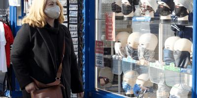 Woman shopper looking at masks