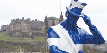 Johnnie Walker striding man and Edinburgh castle